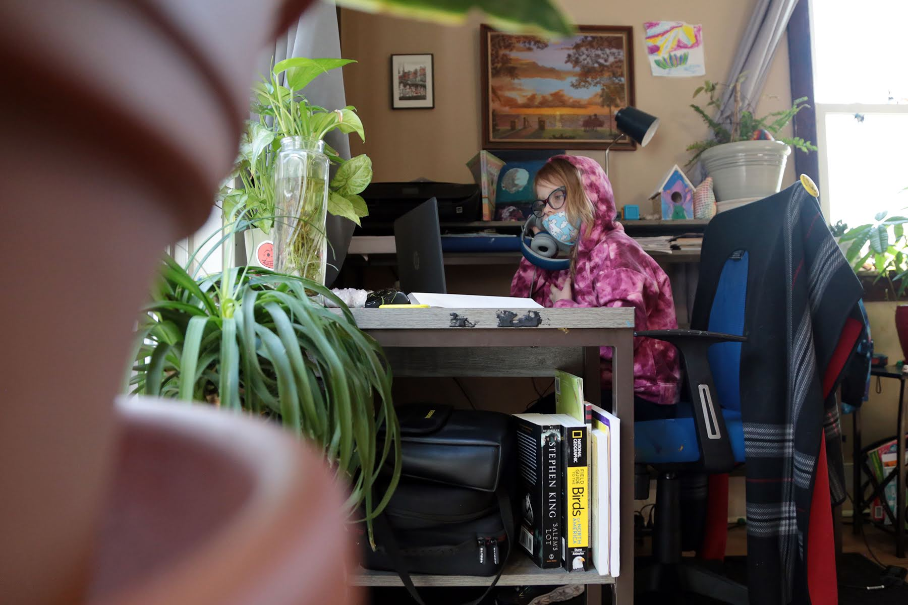 Zora Klobuchar, 7, a second grader at Myrtle Avenue Elementary School in Castle Shannon, does school work at home. (Photo by Ryan Loew/PublicSource)