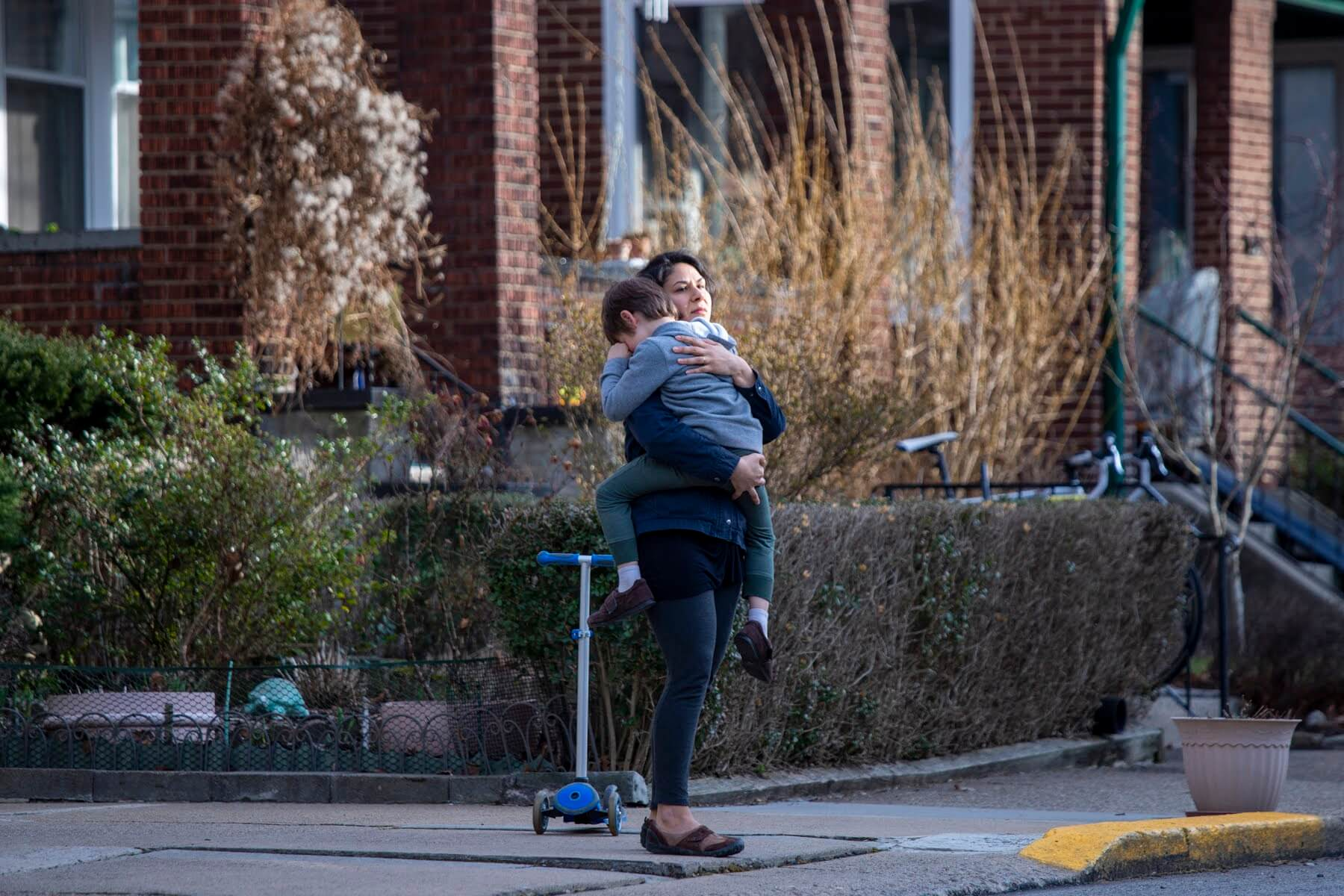 Rachel Masilamani and her son Malcolm in her neighborhood near Wilkinsburg. (Photo by Jay Manning/PublicSource)